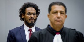 Alleged Al-Qaeda-linked Islamist leader Ahmad Faqi Al Mahdi (L) looks on in the courtroom of the International Criminal Court (ICC) on September 30, 2015, in The Hague. Ahmad Al Faqi Al Mahdi was transferred to the ICC on September 26 following an arrest warrant issued by the Court on September 18 facing charges of ordering the destruction of monuments in Mali's fabled city of Timbuktu. AFP PHOTO / ANP POOL / ROBIN VAN LONKHUIJSEM   ==NETHERLANDS OUT==        (Photo credit should read ROBIN VAN LONKHUIJSEN/AFP/Getty Images)