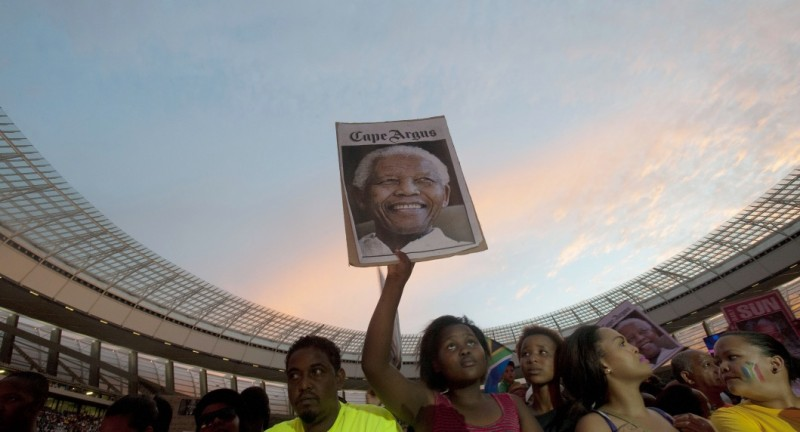 "A woman holds up a poster with a photo of Nelson Mandela , during the Nelson Mandela tribute concert, called, "" A life celebrated"", at Cape Town Stadium on December 11 2013, in Cape Town. Mandela, South Africa's first democratically elected president, and Nobel Peace Prize winner, died at his home in Johannesburg on December 5, 2013. AFP / RODGER BOSCH        (Photo credit should read RODGER BOSCH/AFP/Getty Images)"