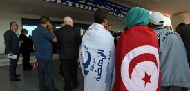 Supporters of Tunisia's Islamist Ennahdha Party wearing the national and party flags arrive on May 20, 2016 to attend the opening of Ennahdha's three-day congress in Tunis. Thousands of people attended the opening ceremony of the congress -- the first since 2012 -- held at a sports complex in Rades, south of the capital Tunis, amid heavy police security. / AFP / FETHI BELAID        (Photo credit should read FETHI BELAID/AFP/Getty Images)