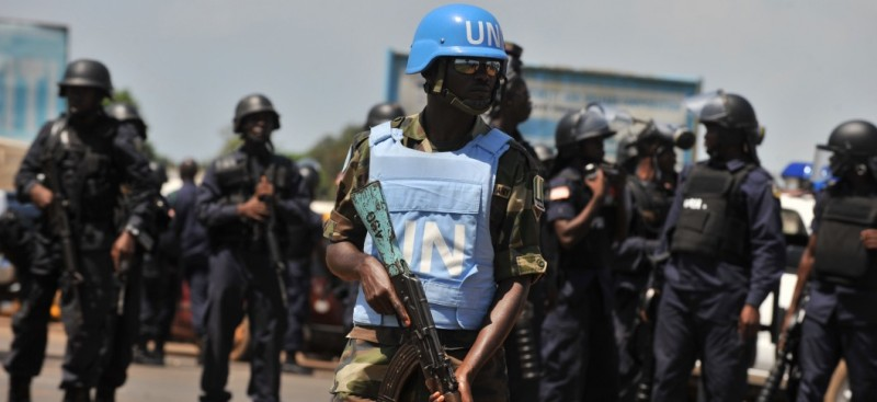 UN troopsand Liberian riot police take position on November 7, 2011 in Monrovia. Police shot dead up to four protestors during a rally in Monrovia, opposition leaders said on November 7 on the eve of a run-off vote they accuse President Ellen Johnson Sirleaf of rigging.  Shooting erupted after anti-riot police and UN peacekeepers using water cannons tried to block an unauthorized march by thousands of demonstrators supporting the opposition challenger Winston Tubman of the Congress for Democratic Change (CDC) party. AFP PHOTO / ISSOUF SANOGO (Photo credit should read ISSOUF SANOGO/AFP/Getty Images)