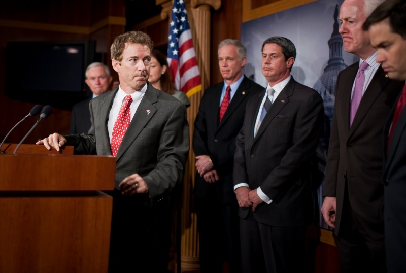 UNITED STATES - JUNE 29:  Sen. Rand Paul, R-Ky., finishes remarks during a news conference in the Capitol with other republican Senators, held to voice their objection to the senate recessing at the end of the week with looming economic issues, such as raising the debt ceiling, remaining unresolved.  Also appearing from left are, Sens. Jeff Sessions, R-Ala., Kelly Ayotte, R-N.H., Ron Johnson, R-Wisc., David Vitter, R-La., John Cornyn, R-Texas, and Marco Rubio, R-Fla. (Photo By Tom Williams/Roll Call)