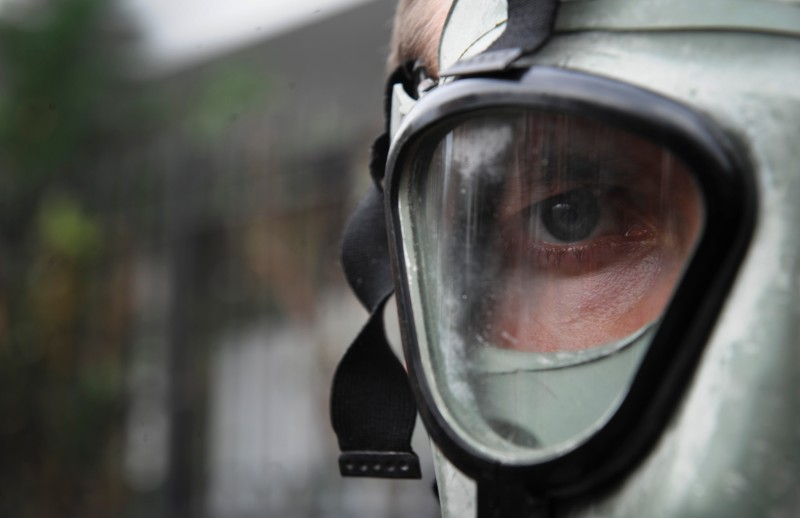 A man wearing a gas mask takes part in a protest against the prospect of using Albania as a site for destroying Syria's chemical weapons stockpile in front of Albanian Embassy in Pristina on November 12, 2013. AFP PHOTO / ARMEND NIMANI        (Photo credit should read ARMEND NIMANI/AFP/Getty Images)