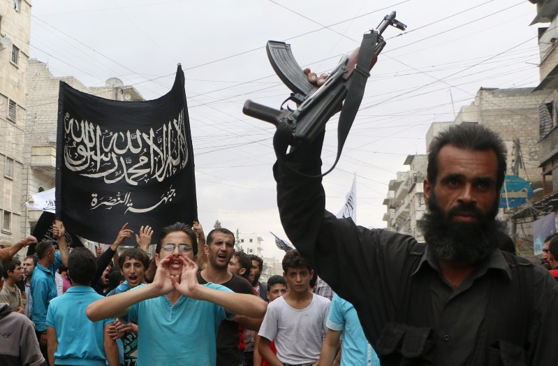 "Supporters of the Al Nusra Front take part in a protest against Syrian President Bashar al-Assad and the international coalition in Aleppo on September 26, 2014. The US struck a little-known group called ""Khorasan"" on September 24, but experts and activists argue it actually struck Al-Qaeda's affiliate Al-Nusra Front, which fights alongside Syrian rebels. AFP PHOTO/ Fadi al-Halabi        (Photo credit should read Fadi al-Halabi/AFP/Getty Images)"