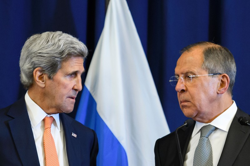 US Secretary of State John Kerry and Russian Foreign Minister Sergei Lavrov look toward one another during a press conference following their meeting in Geneva where they discussed the crisis in Syria on September 9, 2016. The United State and Russia agreed a plan to impose a ceasefire in the Syrian civil war and lay the foundation of a peace process, US Secretary of State John Kerry said.  / AFP / FABRICE COFFRINI        (Photo credit should read FABRICE COFFRINI/AFP/Getty Images)