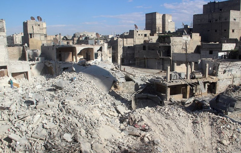 ALEPPO, SYRIA - SEPTEMBER 23: Collapsed buildings are seen after Syrian and Russian amry carried out an airstrike over the residential areas of Kellese town in Aleppo, Syria on September 23, 2016.  (Photo by Ibrahim ebu Leys/Anadolu Agency/Getty Images)
