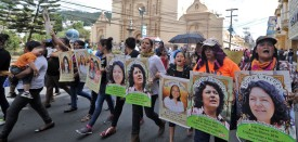 Slain Honduran environmentalist Berta Caceres posters are carried  during a International Women's day demonstration in Tegucigalpa on March 08, 2016.     AFP PHOTO /Orlando SIERRA. / AFP / ORLANDO SIERRA        (Photo credit should read ORLANDO SIERRA/AFP/Getty Images)