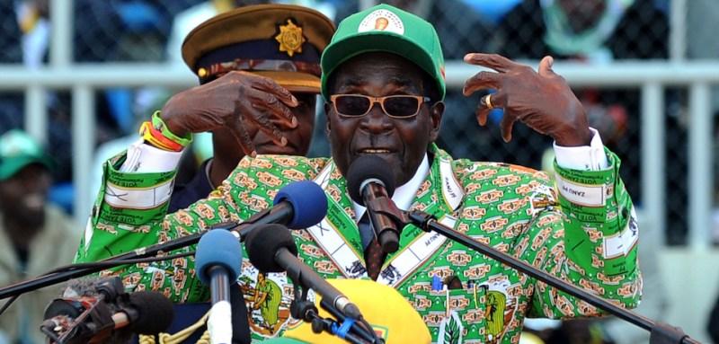 Zimbabwe's President Robert Mugabe addresses at a rally in Harare on July 28, 2013. Zimbabweans go to the polls on July 31 to choose between veteran President Robert Mugabe and long-time rival Morgan Tsvangirai. AFP PHOTO / ALEXANDER JOE        (Photo credit should read ALEXANDER JOE/AFP/Getty Images)