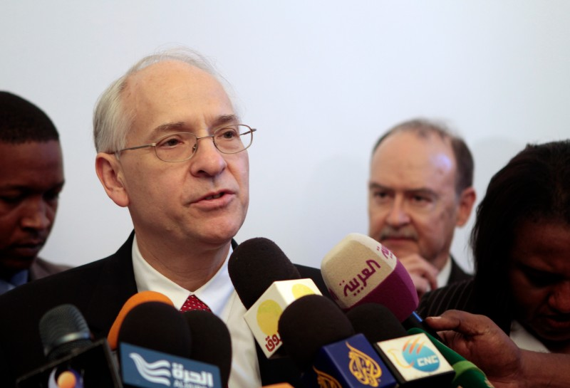 U.S. special envoy to Sudan and South Sudan Donald Booth (C-L) speaks to reporters following a meeting in Khartoum on September 14, 2013. AFP PHOTO / ASHRAF SHAZLY        (Photo credit should read ASHRAF SHAZLY/AFP/Getty Images)