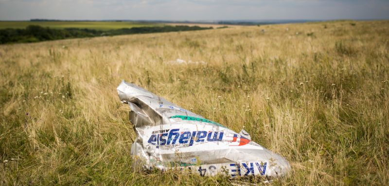 GRABOVO, UKRAINE - JULY 22:  Wreckage from Malaysia Airlines flight MH17 lies in a field on July 22, 2014 in Grabovo, Ukraine.  Malaysia Airlines flight MH17 was travelling from Amsterdam to Kuala Lumpur when it crashed killing all 298 on board including 80 children. The aircraft was allegedly shot down by a missile and investigations continue over the perpetrators of the attack.  (Photo by Rob Stothard/Getty Images)