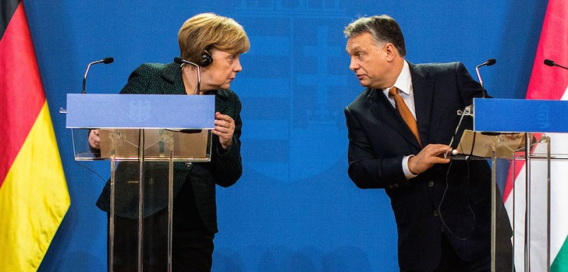 BUDAPEST, HUNGARY - FEBRUARY 02:  German Chancellor Angela Merkel (L) and Hungarian Prime Minister Viktor Orban (R) speak to each other following talks on February 2, 2015 in Budapest, Hungary. Merkel is on a one-day visit to the Hungarian capital in a trip that includes meetings with government leaders, discussions with students at Andrassy University and meetings with local Jewish leaders. Merkel's visit was preceded the day before by demonstrations against the Orban government.  (Photo by Carsten Koall/Getty Images)