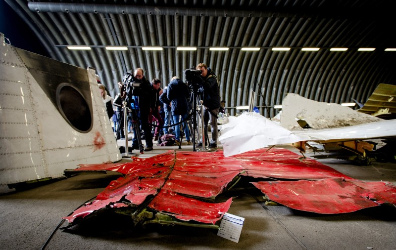 Members of the media film on March 2, 2015 the wreckage of the Malaysia Airlines flight MH17 which was shot down over Ukraine in July 2014, laid out in a hangar on  Gilze-Rijen airbase in the southern Netherlands. The first of around 500 relatives of those killed in the shooting down of MH17 visited the wreckage at a Dutch airbase on March 2, investigators said. The wreckage was brought to the Gilze-Rijen base in the southern Netherlands late last year as part of a probe into what exactly shot down the Boeing 777 in July, killing all 298 people on board. Around two-thirds of those killed were Dutch, while citizens from a total of 11 countries died in the disaster.   AFP PHOTO / ANP / ROBIN VAN LONKHUIJSEN   **NETHERLANDS OUT**        (Photo credit should read ROBIN VAN LONKHUIJSEN/AFP/Getty Images)