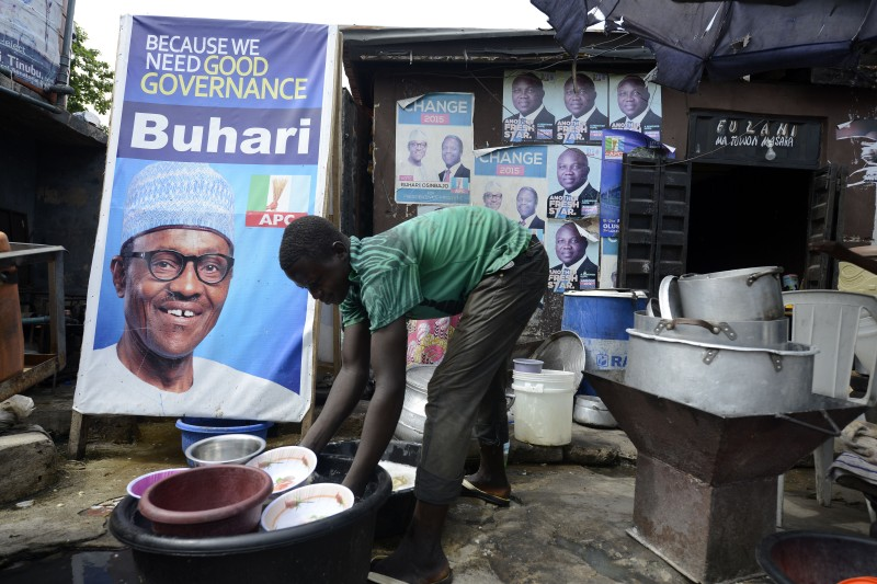 A roadside restaurant features on March 12, 2015 a poster of main opposition All Progressives Congress (APC) presidential candidate Mohammadu Buhari in Lagos. Buhari, the 72-year-old candidate of the APC is in neck-and-neck with President Goodluck Jonathan in the closely fought election campaign, which initially was expected to be held on February 14, but rescheduled for March 28 due to security concern. AFP PHOTO/PIUS UTOMI EKPEI        (Photo credit should read PIUS UTOMI EKPEI/AFP/Getty Images)
