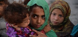 In this photograph taken on July 5, 2015, Afghan children who fled from Kot district of the eastern Nangarhar' province, following threats from the Islamic State group to leave their homes, are pictured at their temporary shelter in Jalalabad. Authorities said more than 250 families had moved from Kot district of the eastern province to Jalalabad, with representatives of the displaced families telling AFP that Islamic State fighters had ordered families whose members were working for the government or Afghan National Security Forces to leave their homes. AFP PHOTO / Noorullah Shirzada        (Photo credit should read Noorullah Shirzada/AFP/Getty Images)