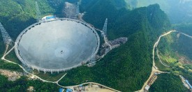PINGTANG, CHINA - MAY 07: (CHINA OUT) Aerial view of the construction site of a Five-hundred-meter Aperture Spherical Telescope (FAST) on May 7, 2016 in Pingtang County, Guizhou Province of China. The dish-like telescope, as large as 30 football fields, will be completed in September 2016.
