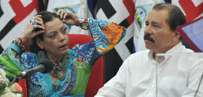 Nicaraguan President and Presidential Candidate Daniel Ortega (R) speaks with his wife Rosario Murillo during delivery of property titles in Managua on October 31, 2011.  Nicaragua will hold presidential elections on November 6.   AFP PHOTO/Rodrigo ARANGUA / AFP / RODRIGO ARANGUA        (Photo credit should read RODRIGO ARANGUA/AFP/Getty Images)