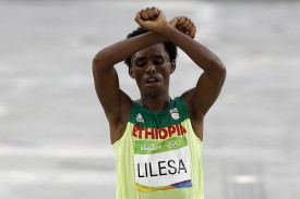 Ethiopia's Feyisa Lilesa crosses the finish line of the men's marathon event at the Summer Olympics in Rio de Janeiro on Aug. 21, 2016. (Adrian Dennis/AFP/Getty Images)