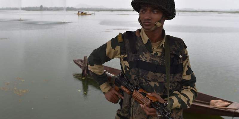 An Indian security personnel stands guard at Dal Lake during curfew in Srinagar on August 28, 2016. Indian-administered Kashmir has been in the grip of almost daily anti-India protests and rolling curfews sparked by the killing on July 8 of a popular rebel leader, Burhan Wani, in a gunfight with government forces. The number of civilians killed since protests erupted in Kashmir hit 68 August 27, while a police constable was also shot dead. / AFP / SAJJAD HUSSAIN        (Photo credit should read SAJJAD HUSSAIN/AFP/Getty Images)