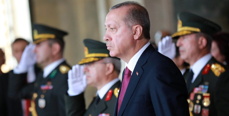 Turkish President Recep Tayyip Erdogan looks on during a ceremony at the Ataturk Mausoleum to mark 94th anniversary of Turkeys Victory Day in Ankara on August 30, 2016.   Turkish authorities arrested an editor from the leading Hurriyet daily on August 30, continuing a sweep of the media triggered by last month's failed coup, the newspaper said. / AFP / ADEM ALTAN        (Photo credit should read ADEM ALTAN/AFP/Getty Images)
