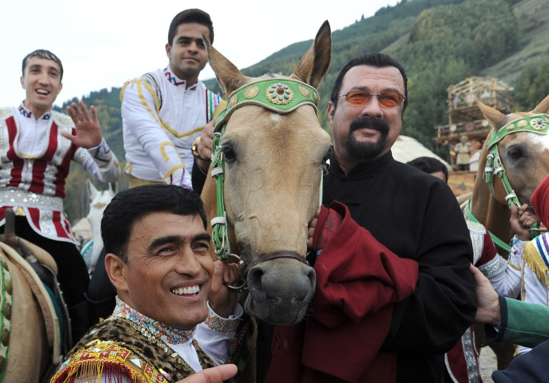 CHOLPON-ATA, KYRGYZSTAN - SEPTEMBER 4, 2016: Hollywood actor Steven Seagal (R) and people in traditional dress in a specially built village setting, Kyrchin, at the 2016 World Nomad Games. Viktor Drachev/TASS (Photo by Viktor DrachevTASS via Getty Images)