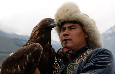 KYRCHYN GORGE,, KYRGYZSTAN - SEPTEMBER 4: An eagle hunter with his bird at the World Nomad Games on September 4, 2016 in Cholpon-Ata, Kyrgyzstan. Kyrgyzstan is hosting the second World Nomad Games dedicated to the sports of Central Asia. Over 40 countries are taking part. (Photo by Olivia Harris/Getty Images)