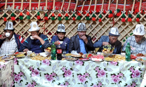 CHOLPON-ATA, KYRGYZSTAN - SEPTEMBER 3, 2016: A feast in a specially built village setting, Kyrchin, at the 2016 World Nomad Games. Viktor Drachev/TASS (Photo by Viktor DrachevTASS via Getty Images)