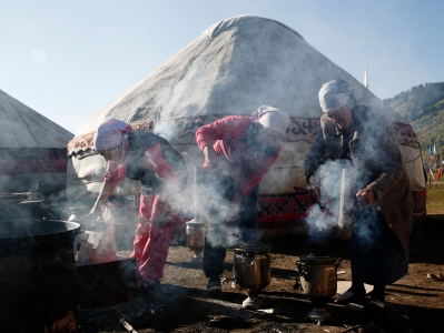 KYRCHYN GORGE, KYRGYZSTAN - SEPTEMBER 6: Women light stoves for breakfast during the World Nomad Games on September 6, 2016 in Kyrchyn Gorge, Kyrgyzstan. Kyrgyzstan is hosting the second World Nomad Games dedicated to the sports of Central Asia. Over 40 countries are taking part. (Photo by Olivia Harris/Getty Images)