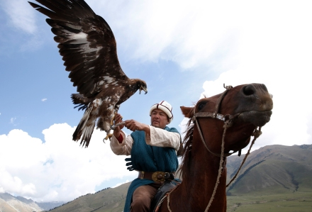 KYRCHYN GORGE, KYRGYZSTAN - SEPTEMBER 6: A man handles an eagle at the World Nomad Games on September 6, 2016 in Kyrchyn Gorge, Kyrgyzstan. Kyrgyzstan is hosting the second World Nomad Games dedicated to the sports of Central Asia. Over 40 countries are taking part. (Photo by Olivia Harris/Getty Images)