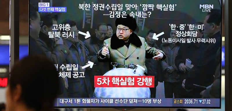 A woman watches a television screen showing an image of Kim Jong Un, leader of North Korea, center, during a news broadcast on North Korea's nuclear test at Gimhae International Airport in Busan, South Korea, on Friday, Sept. 9, 2016. North Korea conducted its fifth nuclear test on Friday, the anniversary of the reclusive nation's founding, and said it was now able to produce miniaturized nuclear arms. Photographer: SeongJoon Cho/Bloomberg