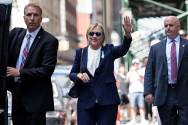 "US Democratic presidential nominee Hillary Clinton waves to the press as she leaves her daughter's apartment building after resting on September 11, 2016 in New York. Clinton departed from a remembrance ceremony on the 15th anniversary of the 9/11 attacks after feeling ""overheated,"" but was later doing ""much better,"" her campaign said. / AFP / Brendan Smialowski        (Photo credit should read BRENDAN SMIALOWSKI/AFP/Getty Images)"