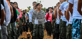 TOPSHOT - Members of the Revolutionary Armed Forces of Colombia (FARC) attend the opening ceremony of the September 17-23 10th National Guerrilla Conference at the camp in Llanos del Yari, Caqueta department, Colombia, on September 17, 2016. After 52 years of armed conflict, FARC rebels open what leaders hope will be their last conference as a guerrilla army, where they are due to vote on a historic peace deal with the Colombian government. / AFP / LUIS ACOSTA        (Photo credit should read LUIS ACOSTA/AFP/Getty Images)
