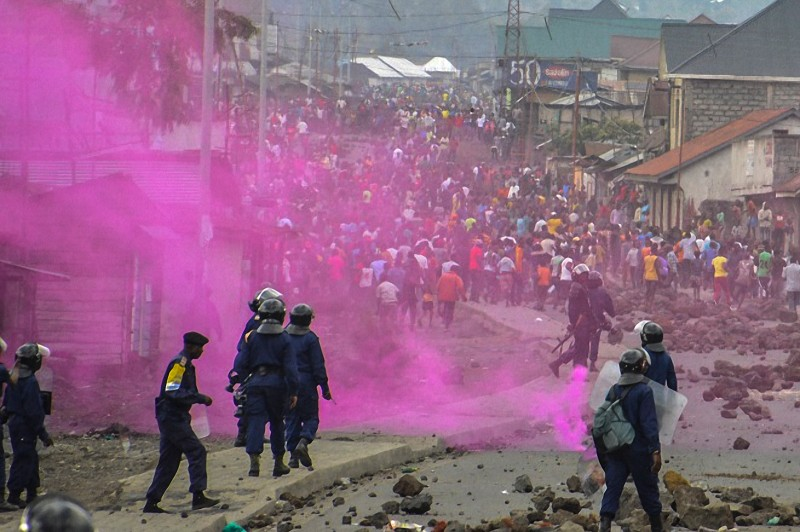 """TOPSHOT - Flares are launched by DRCongo Police forces during a demonstration in Goma on September 19, 2016. At least 17 people, mostly civilians, were killed on September 19, 2016 when clashes erupted ahead of a planned opposition rally in the Congolese capital Kinshasa, a minister said, warning the toll was """"provisional"""". It was the worst violence in Kinshasa since January 2015 when a police crackdown on another opposition protest left several dozen people dead. Demonstrators were to demand the resignation of President Joseph Kabila, who has ruled the Democratic Republic of Congo since 2001. Opponents fear he is planning to extend his rule unconstitutionally.  / AFP / Mustafa MULOPWE        (Photo credit should read MUSTAFA MULOPWE/AFP/Getty Images)"""