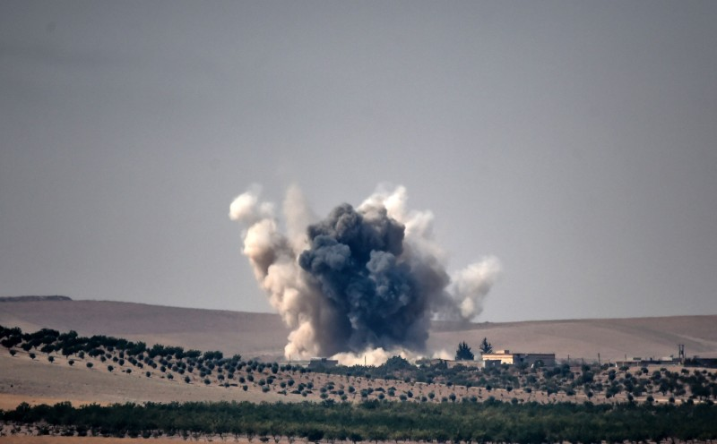 This picture taken from the Turkish Syrian border city of Karkamis in the southern region of Gaziantep, on August 24, 2016 shows smoke billows following air strikes by a Turkish Army jet fighter on the Syrian Turkish border village of Jarabulus during fighting against IS targets. Turkey's army backed by international coalition air strikes launched an operation involving fighter jets and elite ground troops to drive Islamic State jihadists out of a key Syrian border town. / AFP / BULENT KILIC        (Photo credit should read BULENT KILIC/AFP/Getty Images)