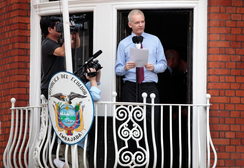 LONDON, ENGLAND - AUGUST 19:  Wikileaks founder Julian Assange speaks from the balcony of the Equador embassy in Knightsbridge on August 19, 2012 in London, England. During his speech, Mr Assange called for the United States to bring an end to its 'Witch Hunt' against Wikileaks staff and supporters. He is currently living inside Ecuador's London embassy after being granted political asylum whilst facing extradition to Sweden to face allegations of sexual assault. It has been suggested by Ecuador's president Rafael Correa that Mr Assange might co-operate with Sweden if they promised that he would not be extradited to a third country. (Photo by Rosie Hallam/Getty Images)