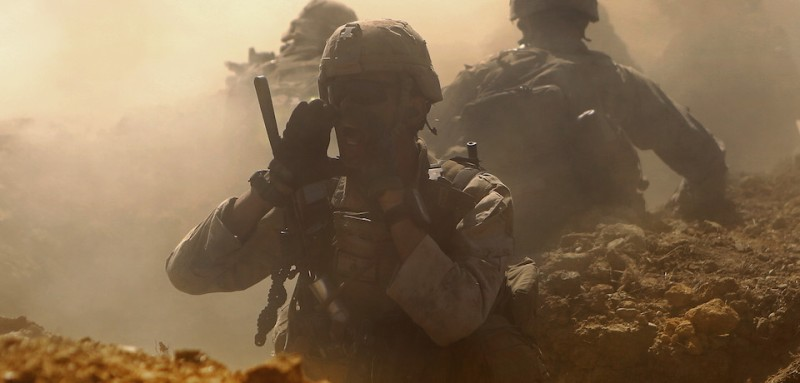A Marine with Company B, 1st Battalion, 1st Marine Regiment, yells orders at his Marines while attacking an objective during a live-fire range movement at Bradshaw Field Training Area, Northern Territory, Australia Aug. 10, 2016. The Marines are part of Marine Rotational Force Darwin and are taking part in Exercise Koolendong 16. The range also included close air support, mortars, sniper over watch and the Combined Anti-Armored Team. (U.S. Marine Corps photo by Sgt. Sarah Anderson)