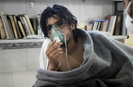 IDLIB, SYRIA - APRIL 17: A Syrian man receives treatment at the Sarmin field hospital following a suspected chlorine gas attack by Asad regime forces in Idlib, Syria on April 17, 2015. (Photo by Stringer/Anadolu Agency/Getty Images)