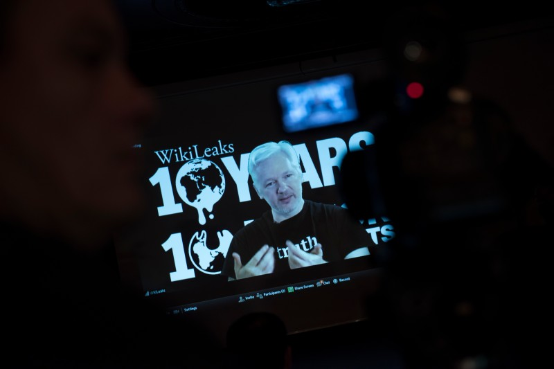 Julian Assange, founder of the online leaking platform WikiLeaks, is seen on a screen as he addresses journalists via a live video connection during a press conference on the platform's 10th anniversary on October 4, 2016 in Berlin. WikiLeaks celebrates its 10th birthday defiantly proud as the pioneer of online leaking platforms, while its controversial founder vows to pursue its work despite widespread criticsm. / AFP / STEFFI LOOS        (Photo credit should read STEFFI LOOS/AFP/Getty Images)