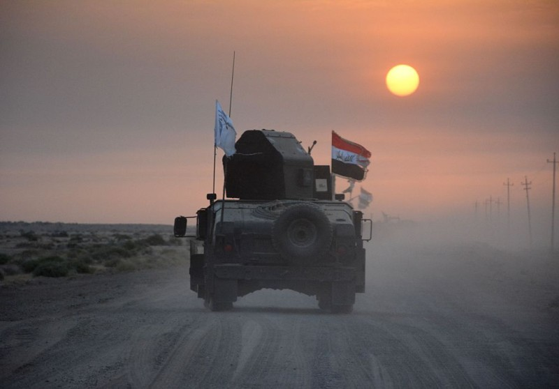 Pro-government forces drive in military vehicles in Iraq's eastern Salaheddin province, south of Hawijah, on October 10, 2016, as they clear the area in preparation for the push to retake the northern Iraqi city of Mosul, the last Islamic State (IS) group held city in Iraq.  / AFP / Mahmoud al-Samarrai        (Photo credit should read MAHMOUD AL-SAMARRAI/AFP/Getty Images)