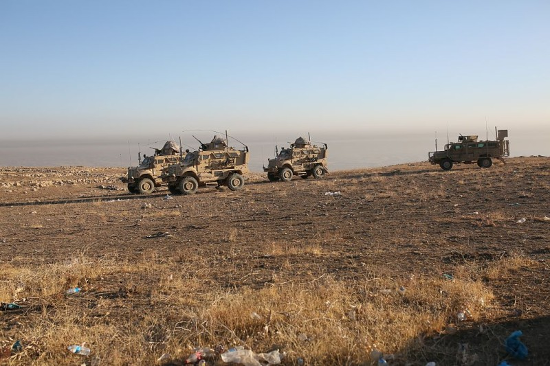 MOSUL, IRAQ - OCTOBER 17: Armored vehicles of the US Army are seen in Bertela region during an operation to retake Iraq's Mosul from Deash in Iraq on October 17, 2016. A much anticipated Mosul offensive to liberate the city from Daesh began midnight Sunday, according to Iraqi Prime Minister Haider al-Abadi.  (Photo by Yunus Keles/Anadolu Agency/Getty Images)