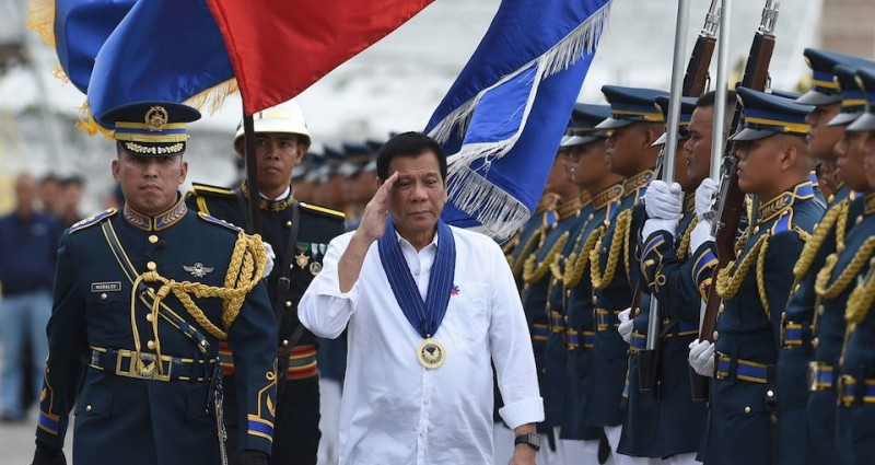 Philippine President Rodrigo Duterte (C) salutes as he reviews the honour guard as he attends the 250th Presidential Airlift Wing Command anniversary celebrations at Villamor air base in Manila on September 13, 2016.  The Philippines assured the United States September 13 it will honour its obligations as a military ally following volleys of profane tirades by unpredictable President Rodrigo Duterte. / AFP / TED ALJIBE        (Photo credit should read TED ALJIBE/AFP/Getty Images)