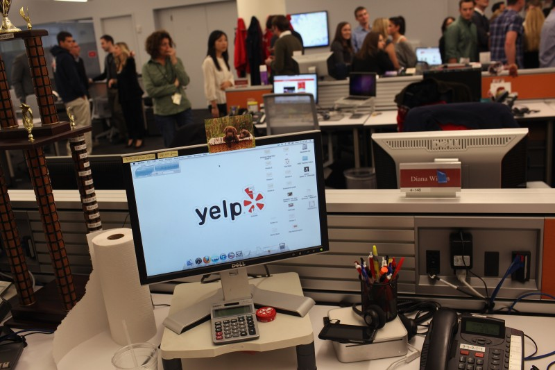 NEW YORK, NY - OCTOBER 26: Employees of the online review site Yelp watch as New York City Mayor Michael Bloomberg speaks at the new East Coast headquarters of the tech company on October 26, 2011 in New York City. The Bloomberg administration has been heralding and working to facilitate the tech sector in New York City in hopes of making New York City a rival to Silicon Valley for start-up companies.  (Photo by Spencer Platt/Getty Images)