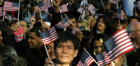 New citizens wave US flags before being sworn in during a Naturalization Ceremony conducted to swear in 125 new citizenship candidates at a ceremony on Liberty Island on October 28, 2011 to commemorate the 125th anniversary of the dedication of the Statue of Liberty.   AFP PHOTO/TIMOTHY A. CLARY (Photo credit should read TIMOTHY A. CLARY/AFP/Getty Images)