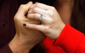 "MARGATE, FL - NOVEMBER 11:  Brian McGuinn holds hands with his wife Anne McGuinn, wearing her 1.5-carat diamond engagement ring on November 11, 2011 in Margate, Florida. Brian says that after realizing he had inadvertantly thrown the ring into the trash October 30, he went to the local waste disposal site the next day where he faced a mountain of rotting garbage. He says he managed to somehow find his trash bag in the mound where he said ""it was absolutely disgusting. It stunk beyond belief.""  (Photo by Joe Raedle/Getty Images)"