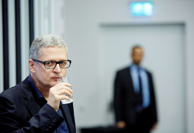 Flemming Rose, the foreign affairs editor at the Danish newspaper Jyllands Posten and author of 'Tyranny of Silence' drinks a glass of water during the book launch of Freedom of Speech under Attack at in The Hague, on April 23, 2015. Flemming Rose was principally responsible for the September 2005 publication of the cartoons that initiated the Jyllands-Posten Muhammad cartoons controversy in early 2006. AFP PHOTO / ANP / MARTIJN BEEKMAN   =NETHERLANDS OUT=        (Photo credit should read Martijn Beekman/AFP/Getty Images)