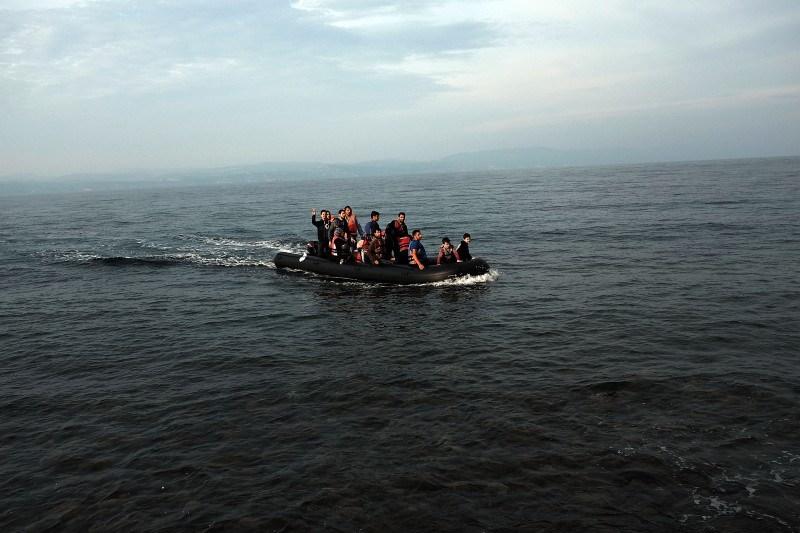 SIKAMINIAS, GREECE - OCTOBER 16:  A raft arrives onto the island of Lesbos on October 16, 2015 in Sikaminias, Greece. Dozens of rafts and boats are still making the journey daily as thousands flee conflict in Iraq, Syria, Afghanistan and other countries. More than 500,000 migrants have entered Europe so far this year. Of that number four-fifths of have paid to be smuggled by sea to Greece from Turkey, the main transit route into the EU. Nearly all of those entering Greece on a boat from Turkey are from the war zones of Syria, Iraq and Afghanistan.  (Photo by Spencer Platt/Getty Images)