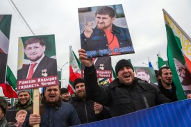 People shout slogans as they hold up images of the head of the Chechen republic Ramzan Kadyrov, during a rally in central Grozny, on January 22, 2016.   Tens of thousands of people flooded into the streets of Grozny, the capital of Russia's North Caucasus region of Chechnya, for a mass state-sponsored demonstration in support of strongman leader Ramzan Kadyrov. / AFP / ILIA VARLAMOV        (Photo credit should read ILIA VARLAMOV/AFP/Getty Images)