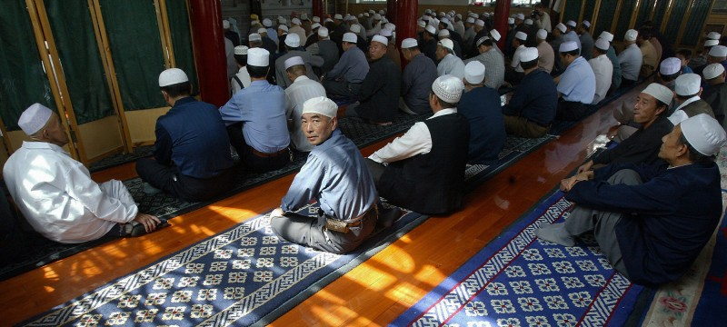 YINCHUAN, CHINA:  Sunlight relfected through the ornate window lattices falls on the famed carpets of Ningxia as Hui Chinese Muslims attend afternoon prayers at Yinchaun Central Mosque, 03 September 2004, in northwest China's Ningxia Hui Autonomous region, where one-third of the population are Hui.  The Hui Chinese Muslims are descended from Arab and Persian traders who settled in China centuries ago, gradually inter-marrying and assimilating with Han Chinese, yet maintaining their practice of Islam.   AFP PHOTO/Frederic J. BROWN  (Photo credit should read FREDERIC J. BROWN/AFP/Getty Images)