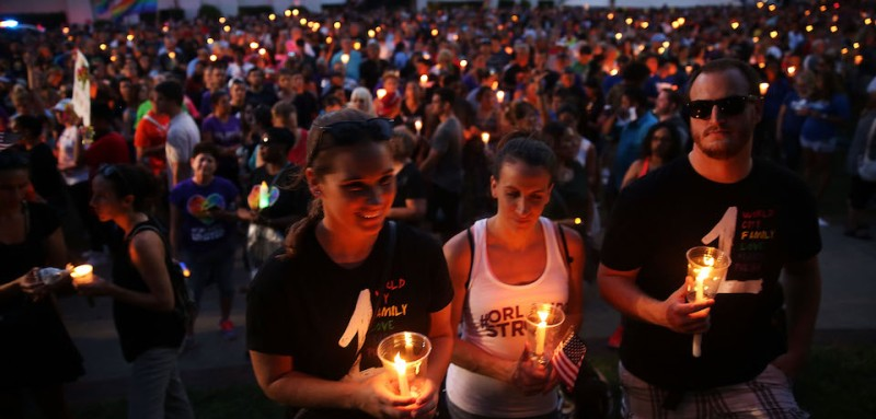 ORLANDO, FL - JUNE 19: People attend a memorial service on June 19, 2016 in Orlando, Florida. Thousands of people are expected at the evening event which will feature entertainers, speakers and a candle vigil at sunset. In what is being called the worst mass shooting in American history, Omar Mir Seddique Mateen killed 49 people at the popular gay nightclub early last Sunday. Fifty-three people were wounded in the attack which authorities and community leaders are still trying to come to terms with. (Photo by Spencer Platt/Getty Images)