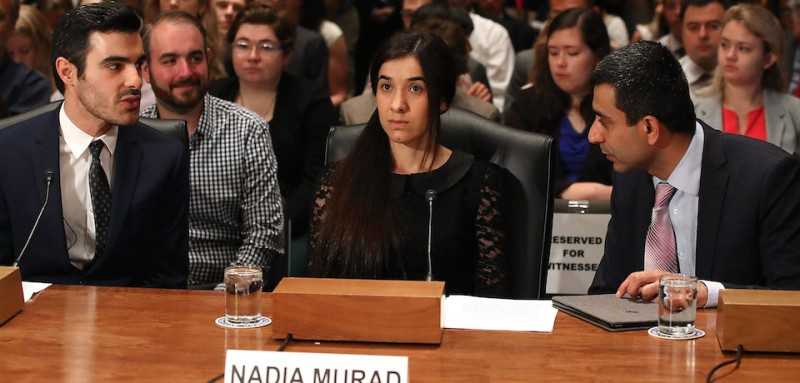 Nadia Murad (center) testifies during a Senate Homeland Security and Governmental Affairs Committee hearing in Washington on June 21, 2016. (Mark Wilson/Getty Images)