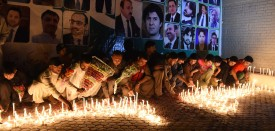 Pakistani residents place candles at the site during a vigil to pay tribute to victims a day after a suicide bombing at the Civil Hospital in Quetta on August 9, 2016.   Pakistan's lawyers boycotted courts and staged protests nationwide on August 9 after a horrific suicide bombing at a Quetta hospital which killed 72 people including many of their colleagues. / AFP / BANARAS KHAN        (Photo credit should read BANARAS KHAN/AFP/Getty Images)