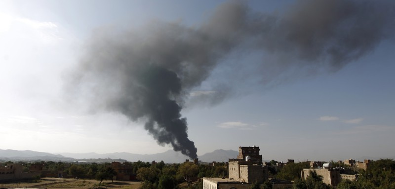 TOPSHOT - Smoke billows on September 14, 2016 following a reported airstrike carried out by the Saudi-led coalition in the Yemeni capital Sanaa. Saudi Arabia has faced repeated criticism from rights groups over civilian casualties in the coalition's military campaign against rebels in Yemen that was launched in March 2015. More than 6,600 people, mostly civilians, have been killed since the intervention of the Saudi-led Arab coalition, according to UN figures.     / AFP / MOHAMMED HUWAIS        (Photo credit should read MOHAMMED HUWAIS/AFP/Getty Images)